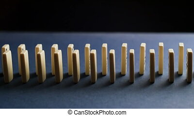 White Dominoes Falling in Chain Reaction. Domino Effect