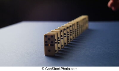 White Dominoes Falling in Chain Reaction. Domino Effect slow
