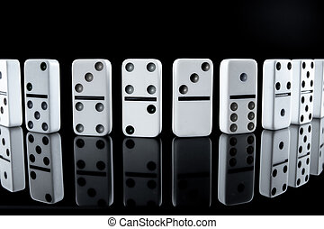 White dominoes in the dark close up