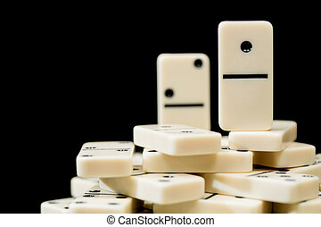 White dominoes showing one above peers - Number One domino ...