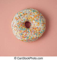 white donut on a pink background