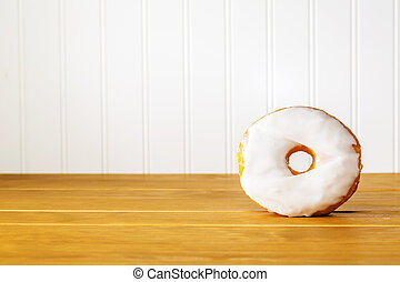 White donut on a wooden table