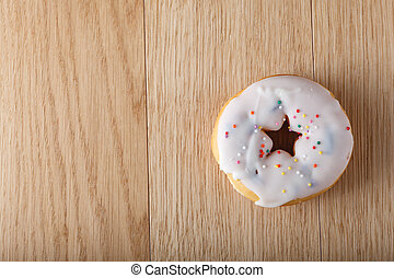 White donut with culinary decoration