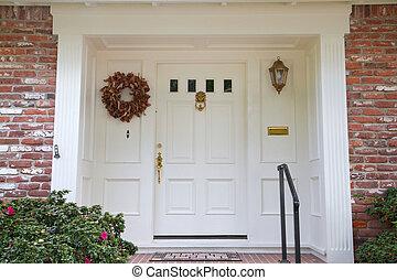White door brick house