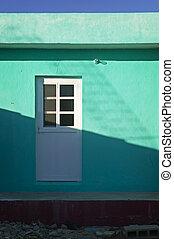 White Door & Green Building