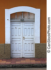 White Door in a Brown Wall