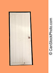 White door on orange wall with house.