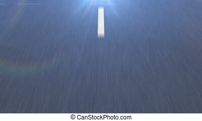 White dotted line on the Asphalt road in motion