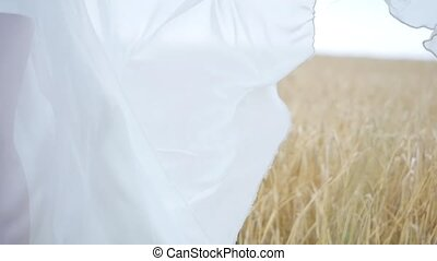 white dress billowing in the wind. girl in a white dress in...