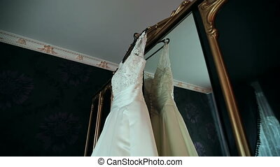 white dress of the bride in a beautiful interior