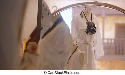 White dress on mannequin in shop
