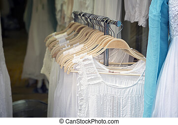 0f5f4669a The range of wedding dresses on hangers and on a mannequin in the ...