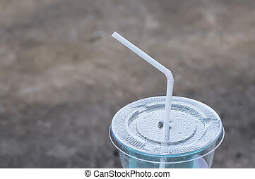 White drinking straw on the disposable plastic cup