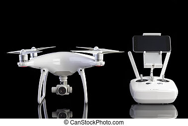 White drone against black background. A studio photo of a...