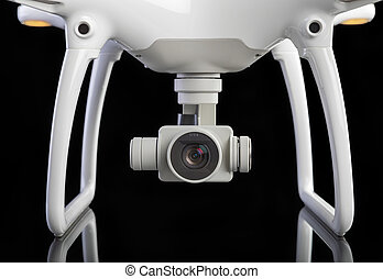 White drone against black background