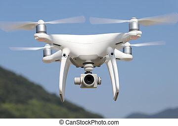 White drone flying in air and clear blue sky