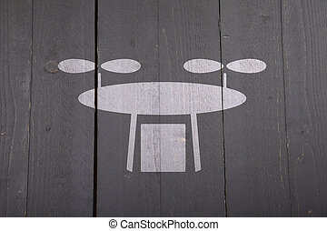 White drone on black wooden background