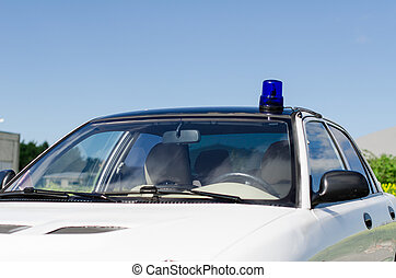 White duty car with blue flasher on top