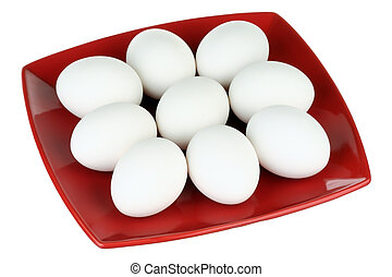 White eggs and red plate