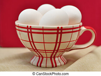 White eggs in a cup