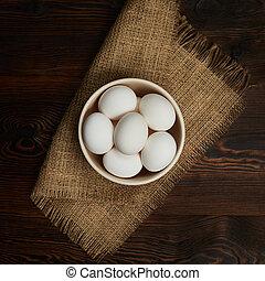 eggs in bowl on burlap rustic napkin