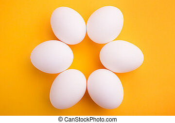 White eggs on a yellow background