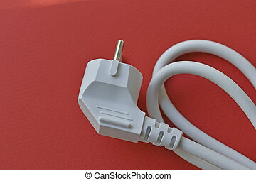 White electric euro plug on red background