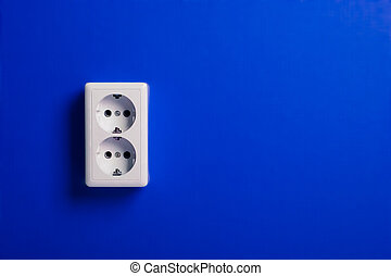 White electric socket on the wall. Close up.