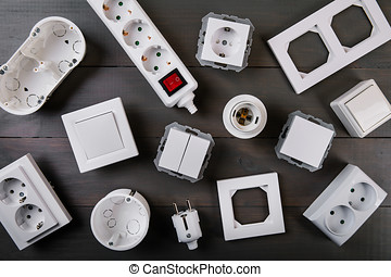 white electrical equipment on wooden background. top view