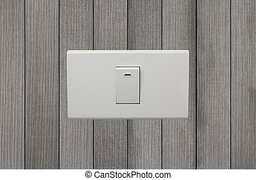 white electrical switch on wooden wall.