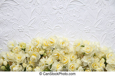 white embossed paper with flowers
