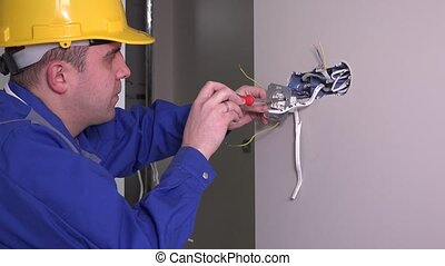 white employee does measure the electrical socket voltage