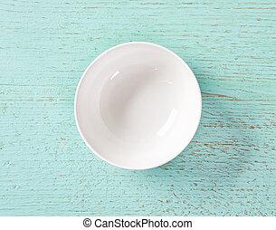 white empty bowl on blue background