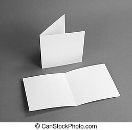 White empty closed card on grey to replace your design.