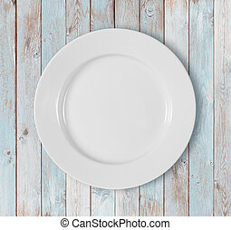 white empty dinner plate on blue wooden table