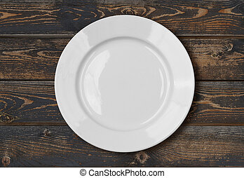 white empty dinner plate on wood table