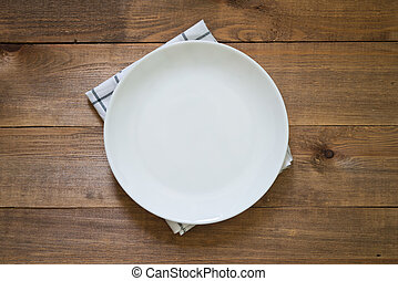 empty plate - white empty plate on wooden background