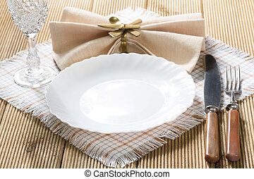 White empty plate on wooden texture background