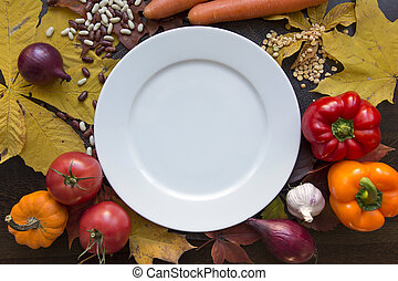 White empty plate with autumn harvest top view