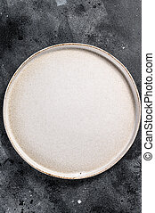 White empty round plate, restaurant background. Black background. Top view. Copy space.