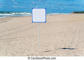 White empty signboard on the beach