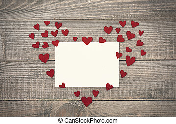 White empty Valentine's card with heart on the wood
