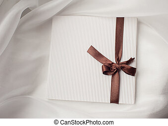 white envelope brown ribbon with a bow and place for text