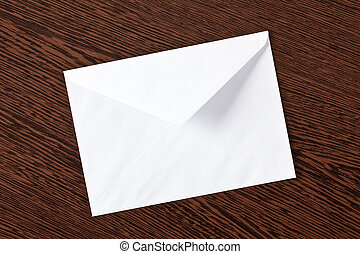 envelope on wooden background