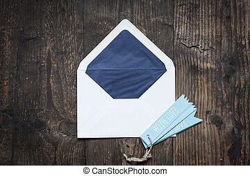 white envelope on wooden background