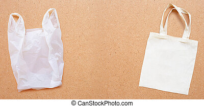 White fabric bag with white plastic bag on plywood ...