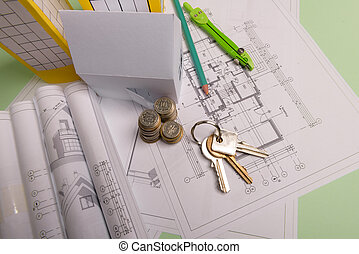 White family paper house , stack of money coins, keys, house projects plan and blueprints on mint background paper. Minimalistic and simple concept, style. Horizontal orientation.
