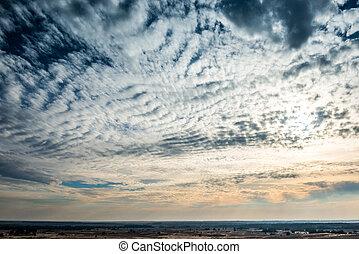 White fantastic clouds in a blue sky