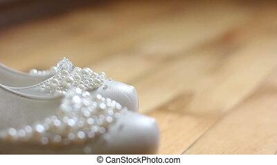 white female wedding shoes. dolly shot