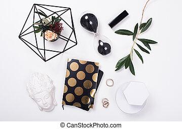 White feminine tabletop flatlay. Home office decor objects.